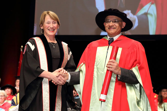 Principal Suzanne Fortier with Prakash Panangaden, winner of the Principal's Prize for Excellence in Teaching in the Full Professor category (2016).<br />Photo: Owen Egan