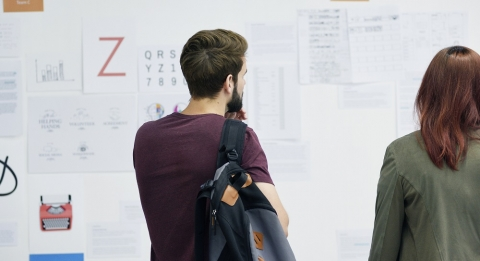 Two students looking at posters