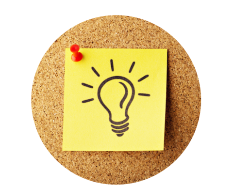 A post-it note with a light bulb pinned to a cork board