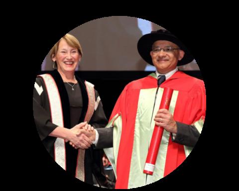 The McGill Principal poses with Principal's Prize recipient