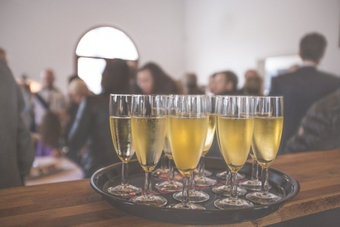 A tray full with champagne filled glasses
