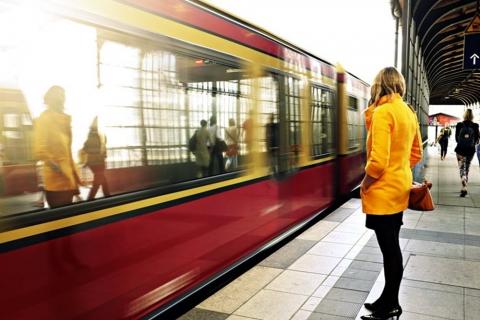 woman waiting at train station