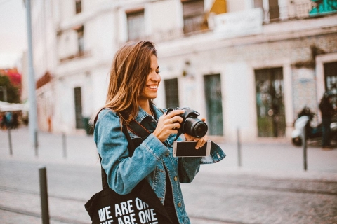 woman with camera smiling