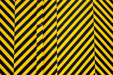 yellow black striped caution paper