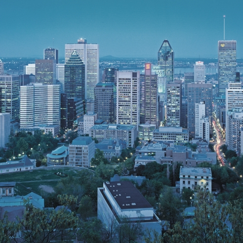 A photo of Montreal's city skyline at dusk.