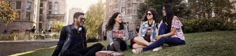 Students sitting outside on campus.