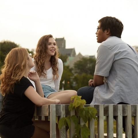 Students talking at a picnic table
