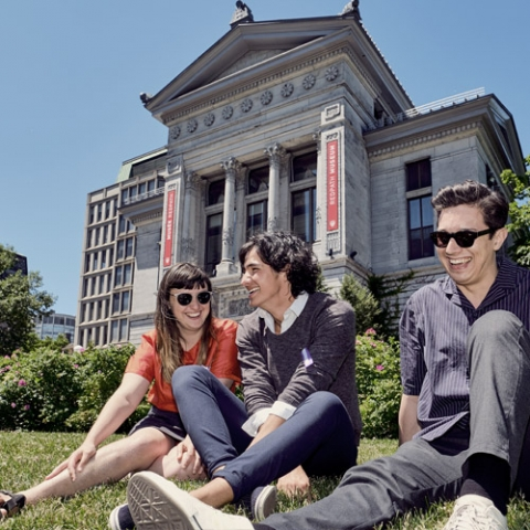 Students sitting outside on a hill at McGill's downtown campus.