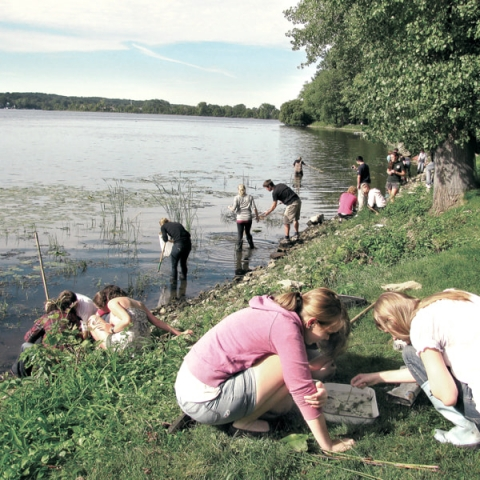 McGill students picking samples near Saint Lawrence River