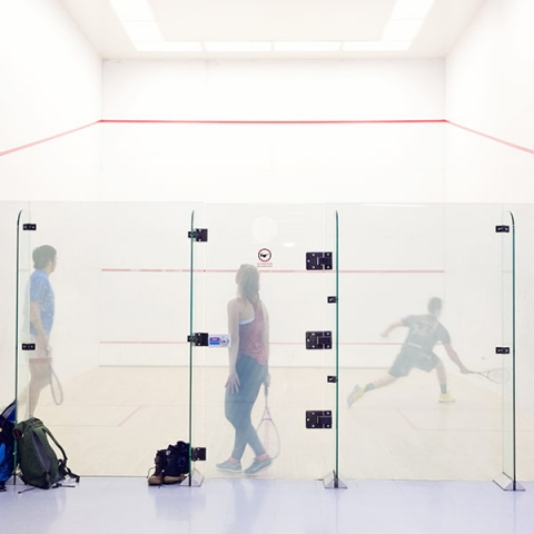 Photo of people playing squash