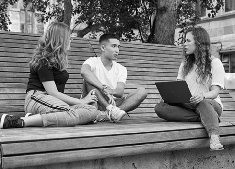 McGill students chatting on downtown campus bench