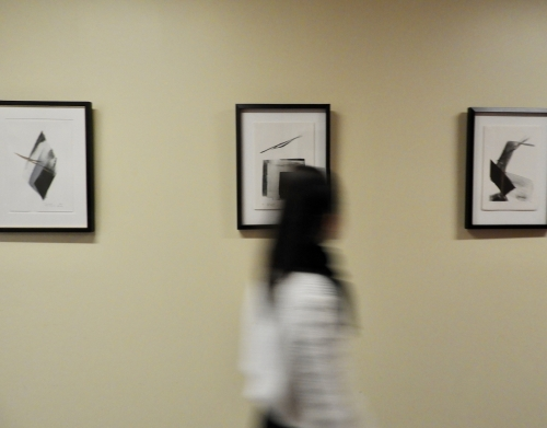 Image of someone walking by the Japanese Prints display in Bronfman.
