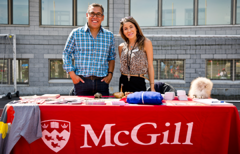 Staff at a McGill branded event table