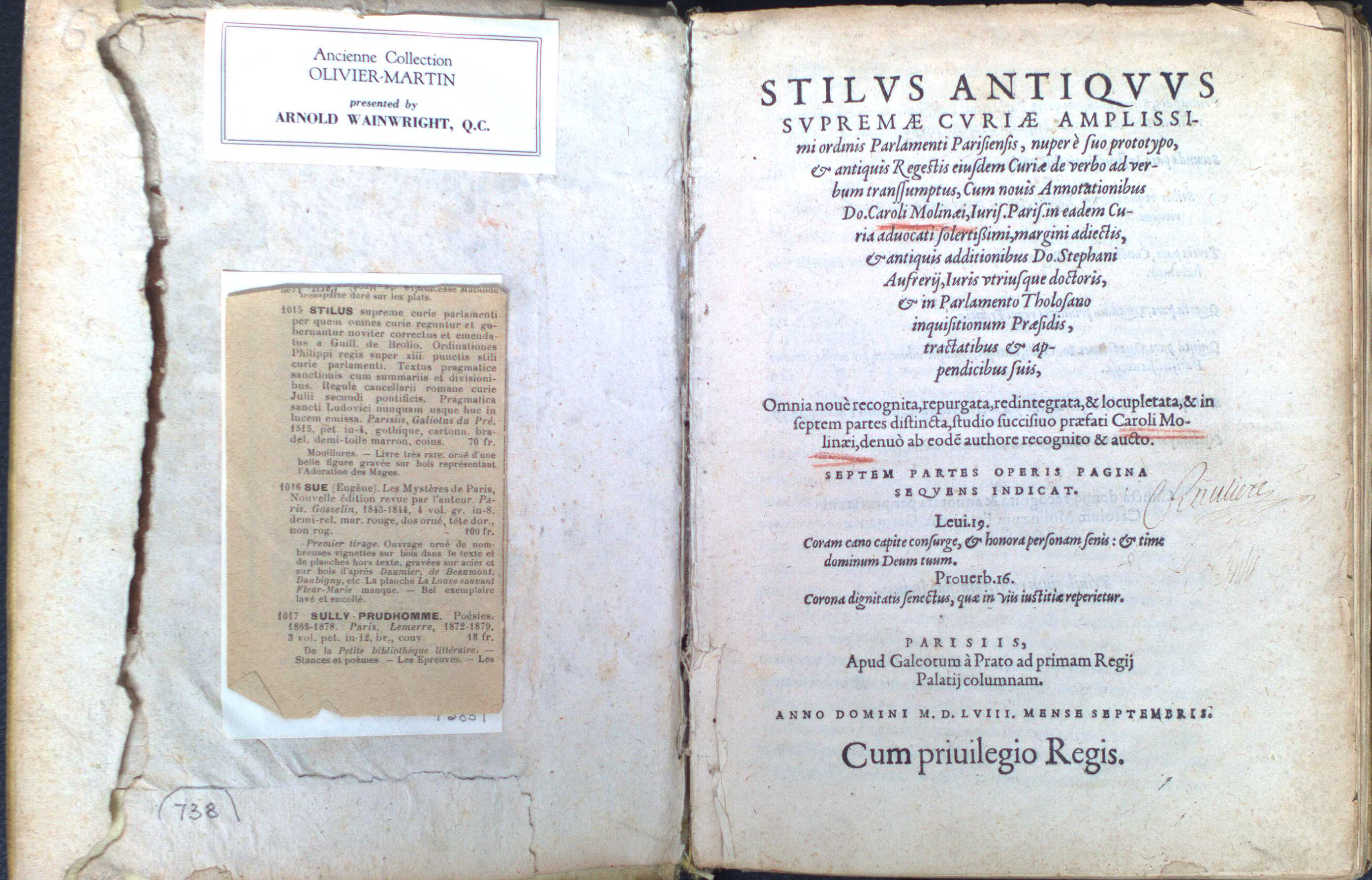 Inside cover of a book with cuttings and markings