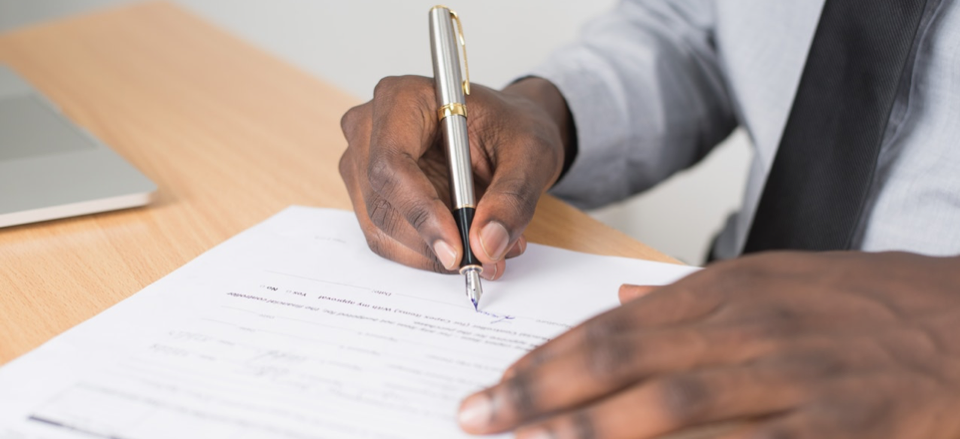 hands filling out a form