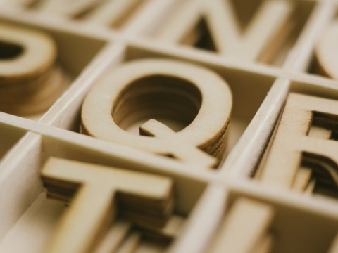 box of wooden letter q