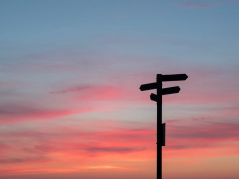 signpost silhouette against sunset