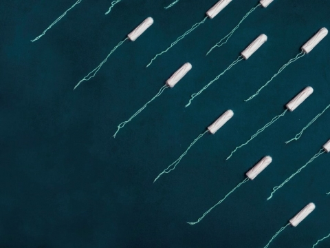 white tampons on blue background